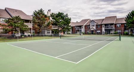Residents Playing Tennis | Apartments for rent in Wheaton, IL | Crossings at Danada