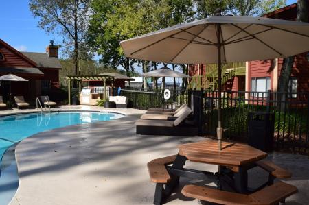 Residents Lounging by the Pool | Jacksonville FL Apartments For Rent | Deerfield Apartments