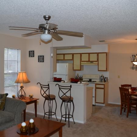 Deerfield Apartments view of apartment from front door. View includes living room, kitchen and dining room areas.