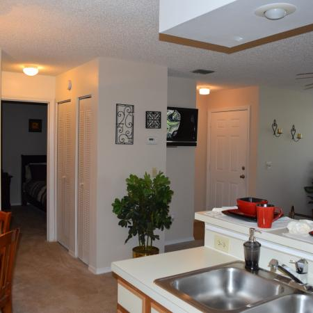 Deerfield Apartments view of entrance, living room and dining room from kitchen