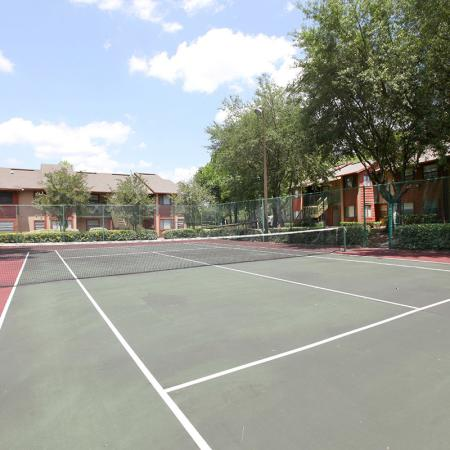 Deerfield Apartments outdoor tennis court on site