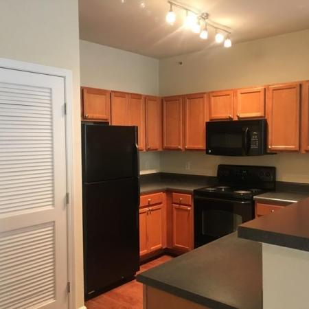Residents Cooking in the Kitchen | Apartments Homes for rent in Knightdale, NC | Greystone at Widewaters