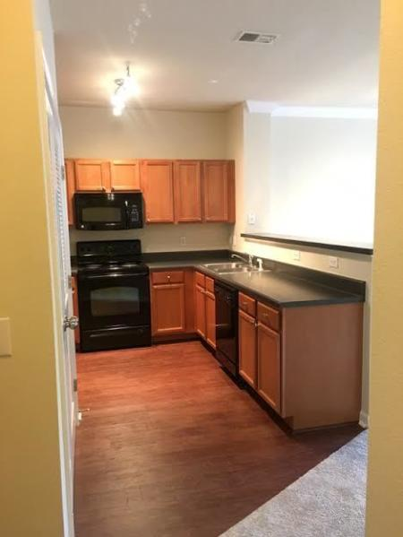 Residents Snacking in the Kitchen | Apartments Knightdale, NC | Greystone at Widewaters