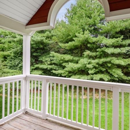 View from Oak floor plan balcony overlooking pine trees.