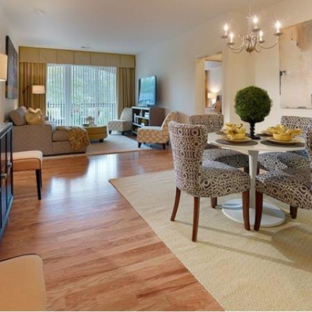 Residents Lounging in the Living Room | Edison NJ Apartments | Queens Gate
