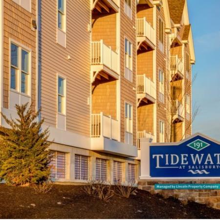 "Monument sign that reads ""Tidewater at Salisbury"" with apartment building in background"