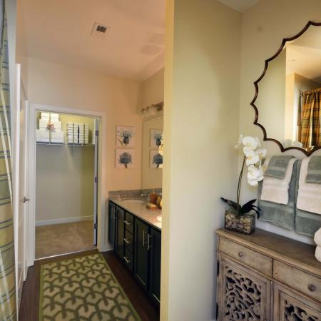 Furnished model master bathroom with access to walk in closet