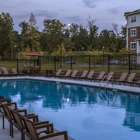 Evening view of saline pool and seating available