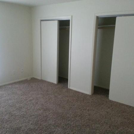 Bedroom with Spacious Walk in Closets and Plush Carpets