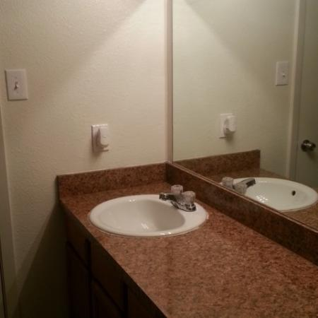 Bathroom with Faux Granite Countertop and Oversized Mirror