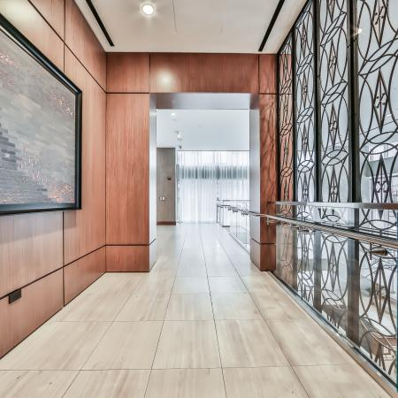 Hallway with wall art, wood flooring and city views
