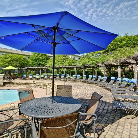 Residents Lounging by the Pool | Atlanta GA Apartments For Rent | Aspire Lenox Park