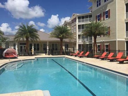 Resort Style Poole with Sundeck l Monterey Pointe Apartments