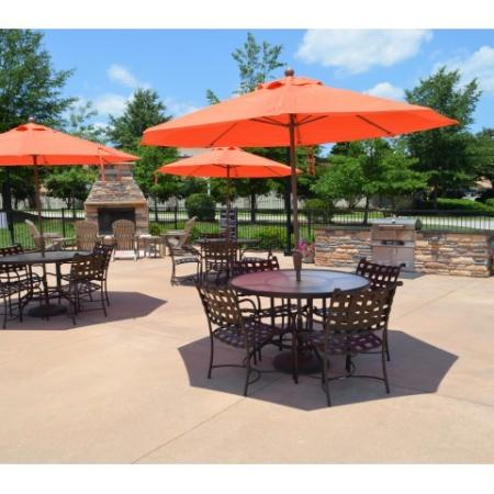 Residents Lounging by the Pool | Knightdale NC Apartments For Rent | Greystone at Widewaters