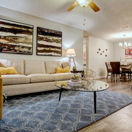 Luxurious Living Room with Wood Inspired Flooring | Apartment Homes in Nashville, TN | Bellevue West