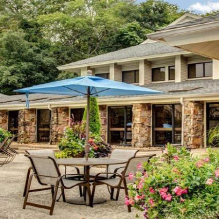 Beautiful Outdoor Table and Chairs with Umbrella | Nashville TN Apartments | Bellevue West