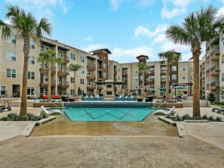 Outdoor Pool | Apartments Homes for rent in Las Colinas, TX | Alexan Las Colinas