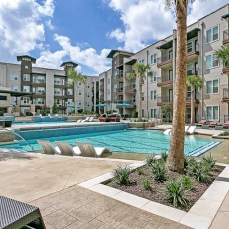 Residents Lounging by the Pool | Las Colinas TX Apartments For Rent | Alexan Las Colinas