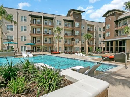 Residents Tanning by the Pool | Las Colinas TX Apartments | Alexan Las Colinas