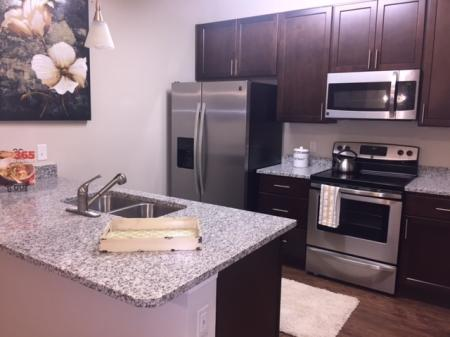 Kitchen with full appliance package and granite countertops l Monterey Pointe