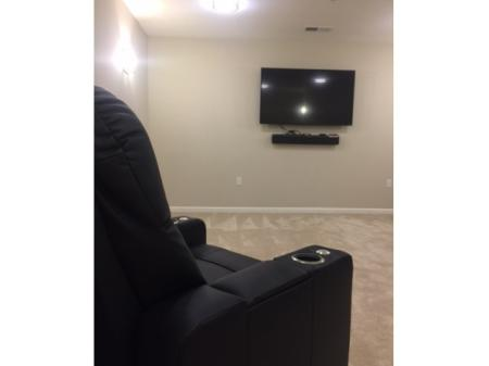 Resident TV Room with Oversized Plush Recliner l Monterey Pointe