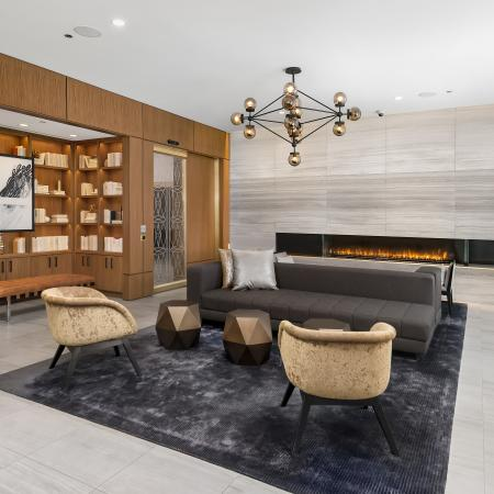 Lounge area with wood flooring and a fireplace