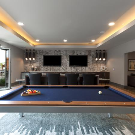 Private lounge with pool table, shuffle board and patio