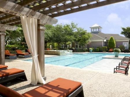 Residents Lounging by the Pool | San Antonio TX Apartments For Rent | Escalante
