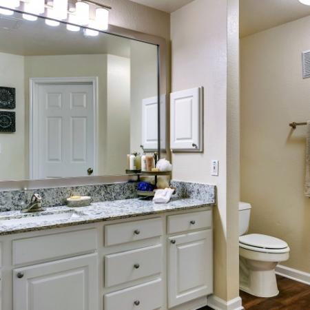 Bathrooms With Large Vanities and White Cabinets