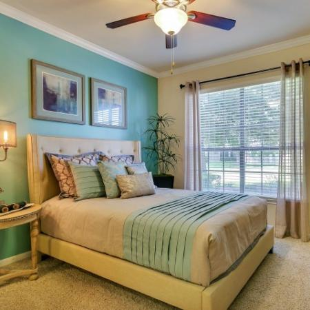 Spacious Bedrooms with Plush Carpet and Ceiling Fans