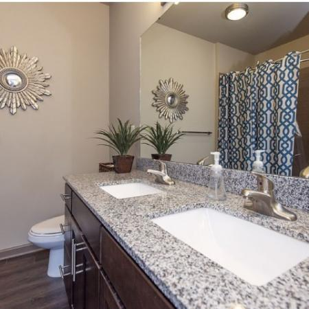 Spacious Master Bathroom with Granite Countertops and Double Undermount Sinks | Apartments Homes for rent in Nashville, TN | 909 Flats