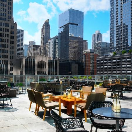 Streeterville Social rooftop dining area at The Loews Hotel