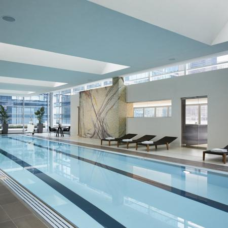 Indoor lap swimming pool at The Loews Hotel with city views