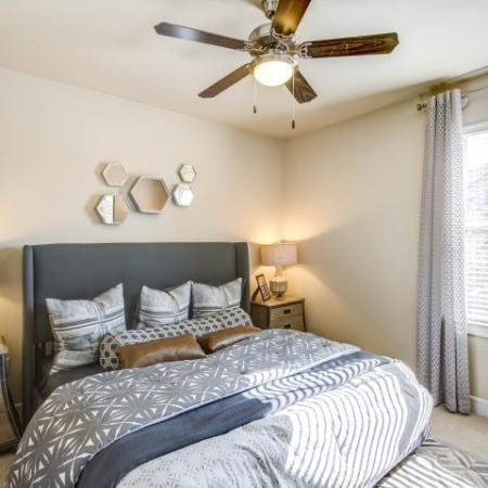 Spacious bedroom large enough to fit a king size bed with soft clean carpet and modern ceiling fan, beautiful natural light.