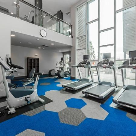 Bi-level fitness center with spin bikes and cardio machines