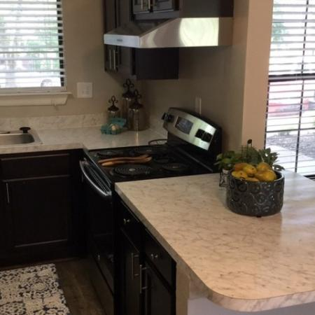 Residents Cooking in the Kitchen | Raleigh North Carolina Apartments | VERT at Six Forks