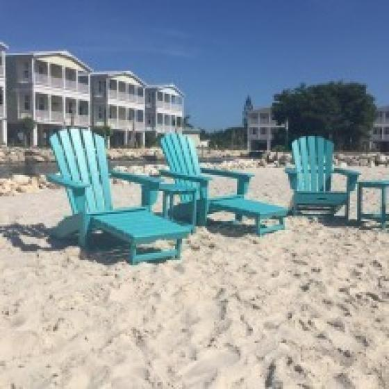 Beach with Blue Adirondack Chairs