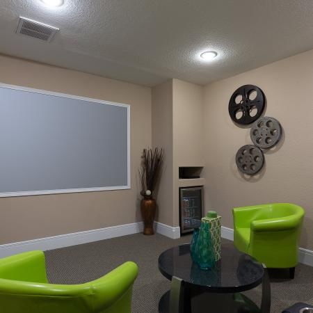Theater room with large screen TV and comfortable seating