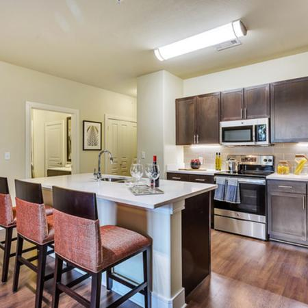 Beautiful open kitchen. Custom kitchen Cabinets, designer tile backsplash Stainless steel GE appliance package, Premium quartz countertops