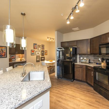 Luxurious Kitchen with Large Island, Pendant Lighting and Designer Tile Backsplash | Nashville Tennessee Apartments for Rent | 909 Flats