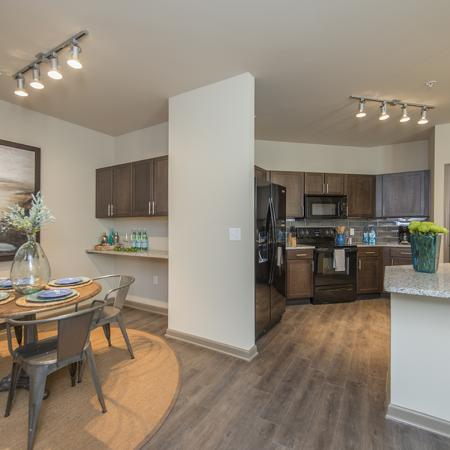 Spacious Dining Room with Work Area and View into Large Open Kitchen  | Apartments in Nashville | 909 Flats