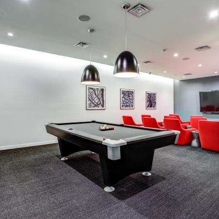 Recreation room with pool table and TV viewing area
