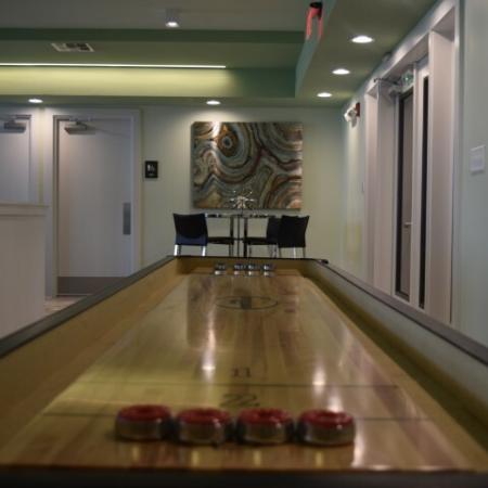 Enjoy playing tabletop shuffleboard in the clubroom