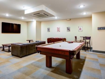 Residents Playing Billiards | Meridia Lafayette Village
