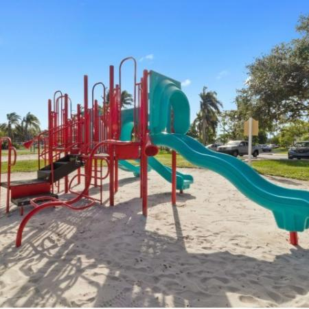 Playground with climbing apparatuses and slides on sand