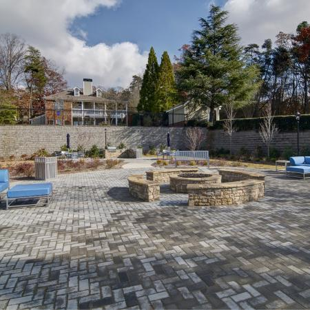 Beautiful stone fire pit with soft seating