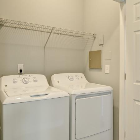 Laundry Room that accommodates full size side by side washer and dryer