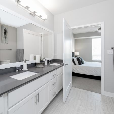 Upgraded bathroom with framed mirror and double vanity sink