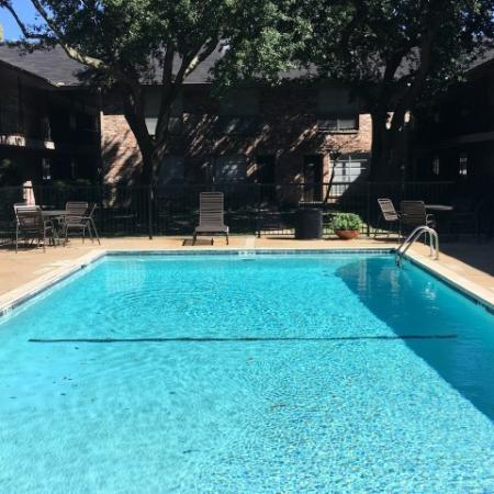 Gated pool surrounded with sitting and tables  | Apartment Homes in Houston, TX | Memorial City