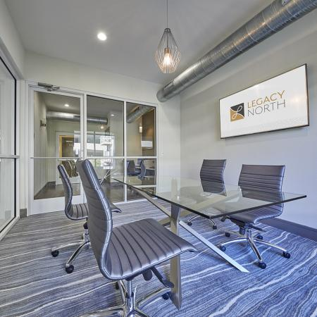 FREE WIFI IN THE BUSINESS CENTER. LARGE GLASS CONFERENCE ROOM TABLE.